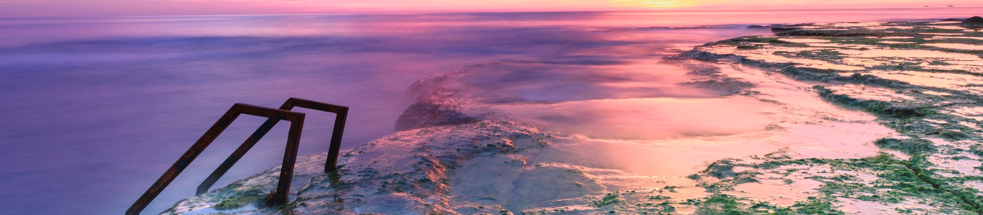 coastline and sea with a purple tint